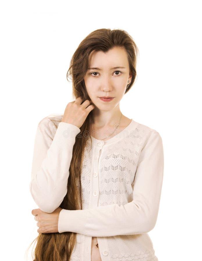 Emoties van een mooi meisje met lang haar, in een wit jasje stock foto