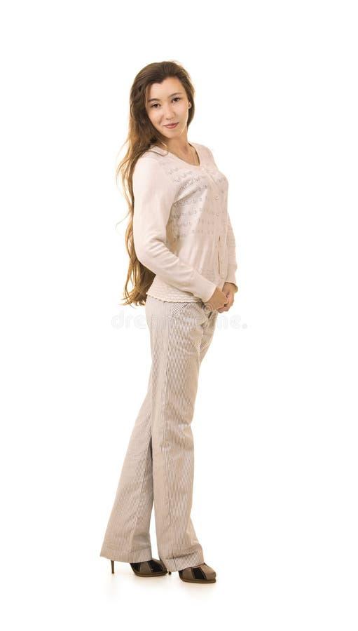Emoties van een mooi meisje met lang haar, in een wit jasje stock foto's