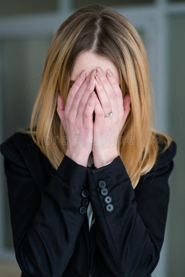 Emotion sad distraught woman covering hands crying royalty free stock image