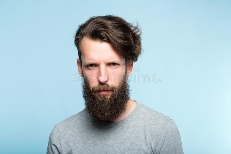 Emotion expression serious frowning grumpy man stock photography