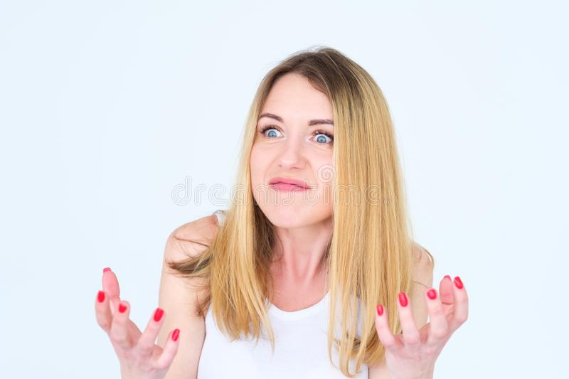 Emotion face angry mad cross furious enraged woman. Emotion face. angry mad cross enraged woman. young beautiful blond girl portrait on white background stock photo