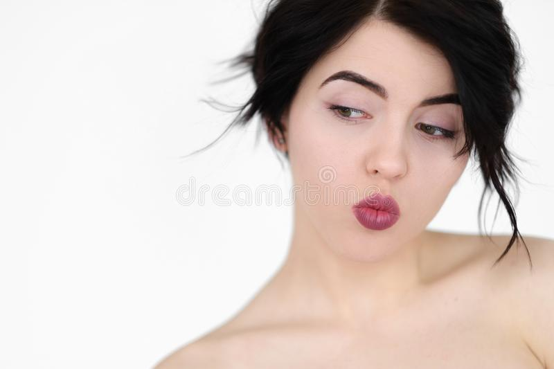 Emotion face playful coquettish naughty woman royalty free stock photos