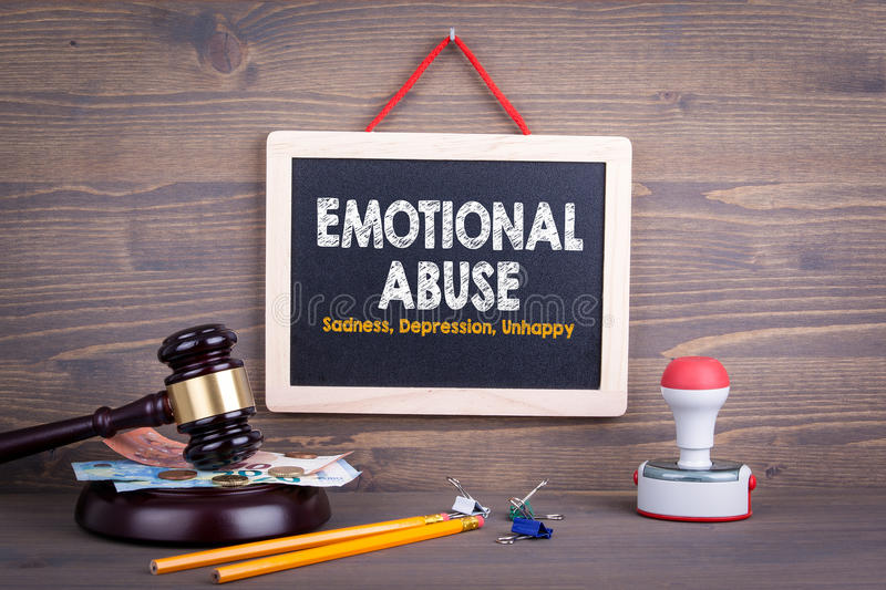 Emotional Abuse concept. Sadness Depression Unhappy. Chalkboard on a wooden background royalty free stock photography