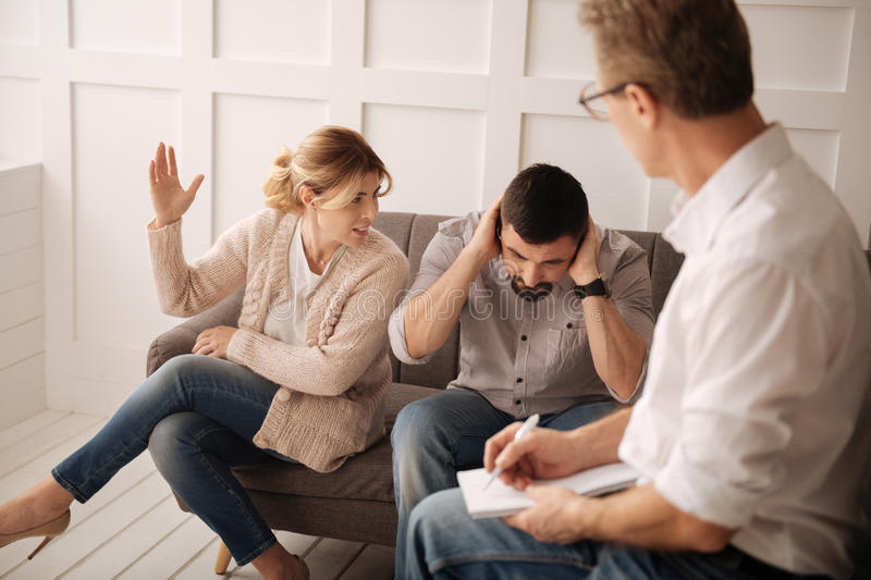 Emotional angry couple having a quarrel stock image