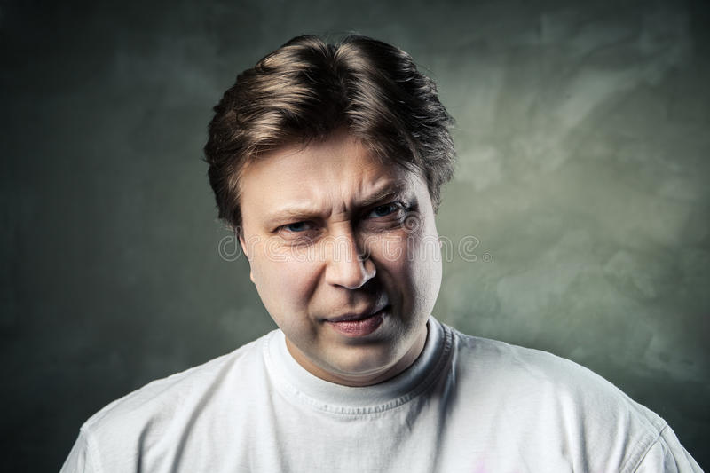 Emotional angry middle aged man over gray royalty free stock image
