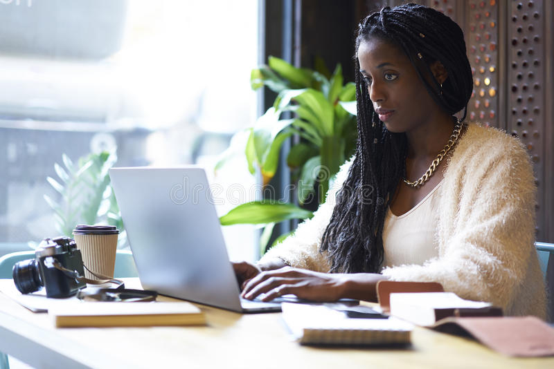 Emotional beautiful afro american woman creating startup project of business company stock photography