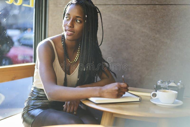 Emotional beautiful afro american woman enjoying good sunny weather royalty free stock photography