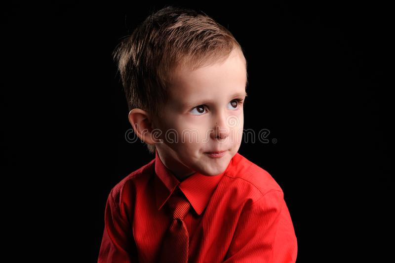 Emotional boy. Portrait of emotionally kid. Emotional boy on the black background, adorable, childhood, defiance, fun, gesture, look, looking, model, male stock photo