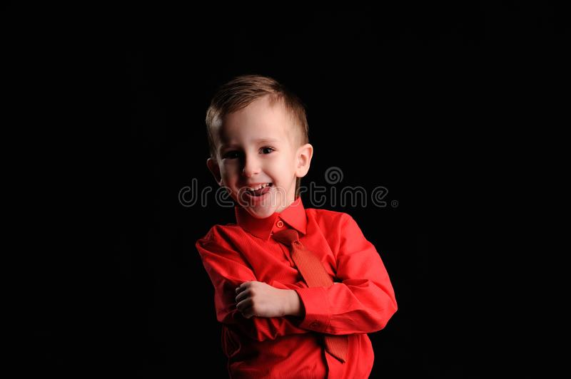 Emotional boy. Portrait of emotionally kid. Emotional boy on the black background, adorable, childhood, defiance, fun, gesture, look, looking, model, male stock photography