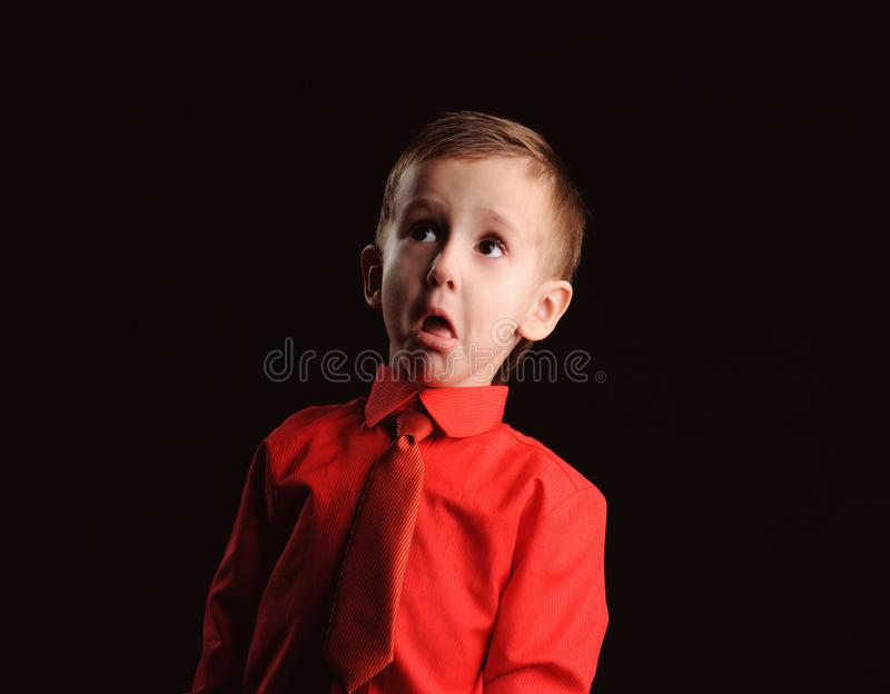 emotional boy in the shirt isolated on the black background royalty free stock photo