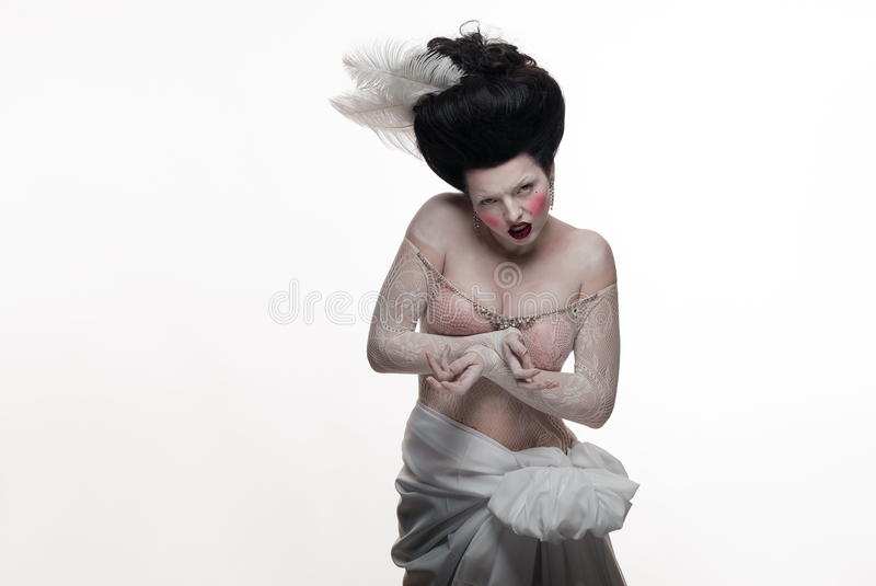 Download Emotional Brunette Actress Lady With White Feathers Stock Photo - Image: 83715456