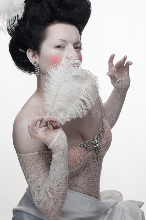 Download Emotional Brunette Actress Lady With White Feathers Stock Photo - Image: 83715618