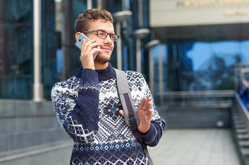 Emotional business man freelancer talking on the phone. Successful conversation with a partner or client, good bargain stock image