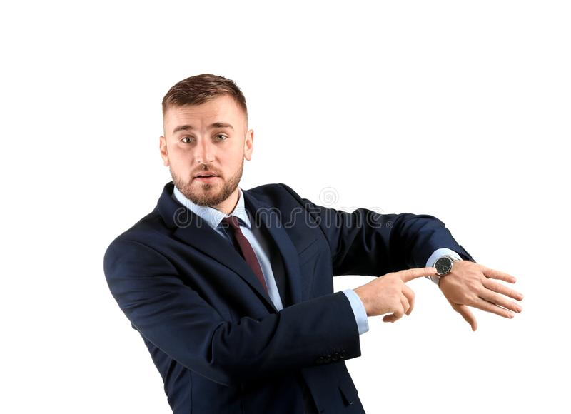 Emotional business man with watch on white background stock image
