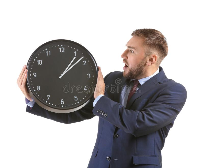 Emotional businessman with clock on white background stock image
