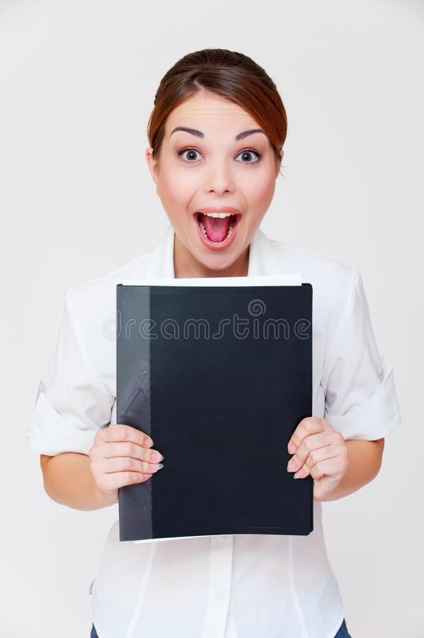 Download Emotional Businesswoman With Black Folder Stock Photo - Image: 15946134