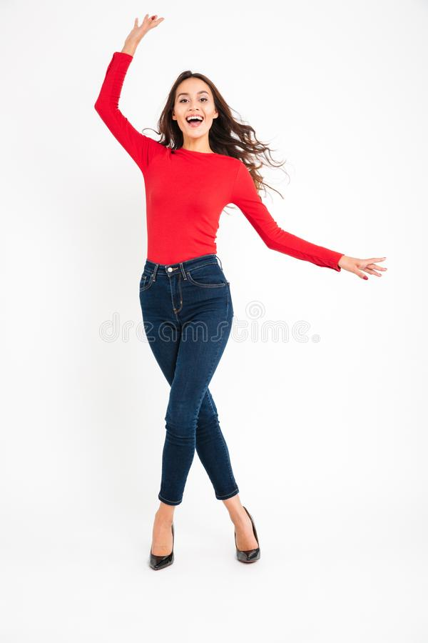 Emotional cheerful woman posing isolated stock photo