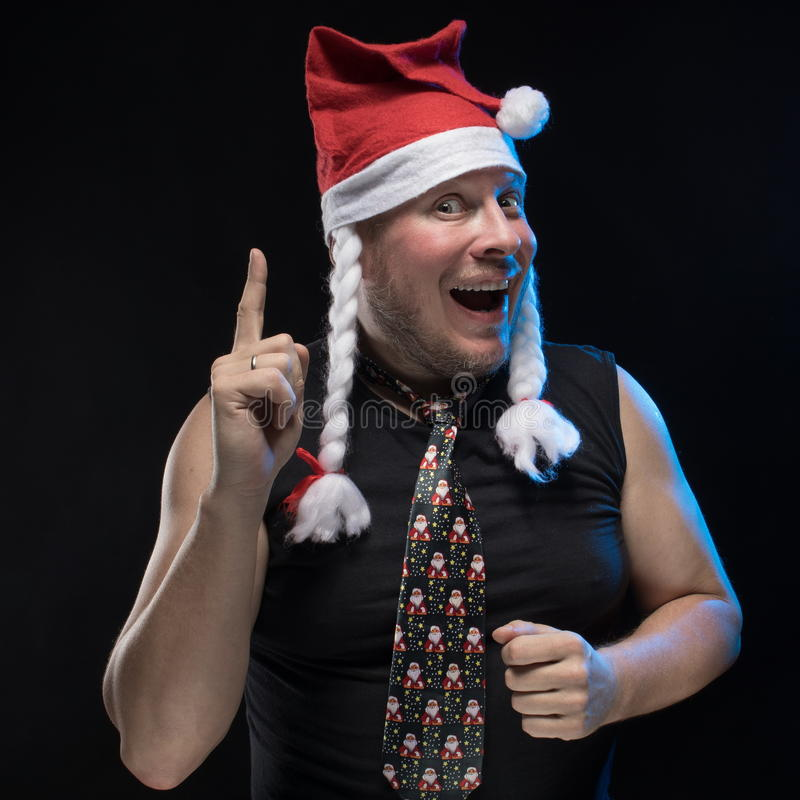 Emotional Comic actor man in cap with braids gesticulates, in anticipation of Christmas and New Year. Emotional Comic actor man in cap with braids gesticulates stock images