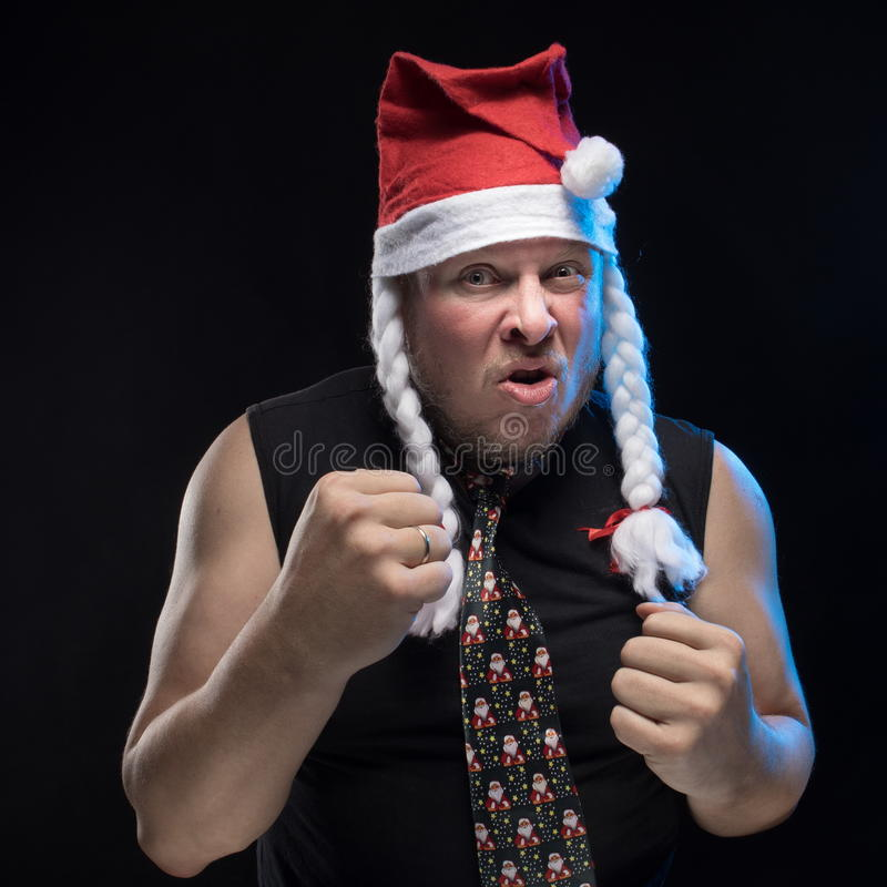 Emotional Comic actor man in cap with braids gesticulates, in anticipation of Christmas and New Year. Emotional Comic actor man in cap with braids gesticulates stock photography