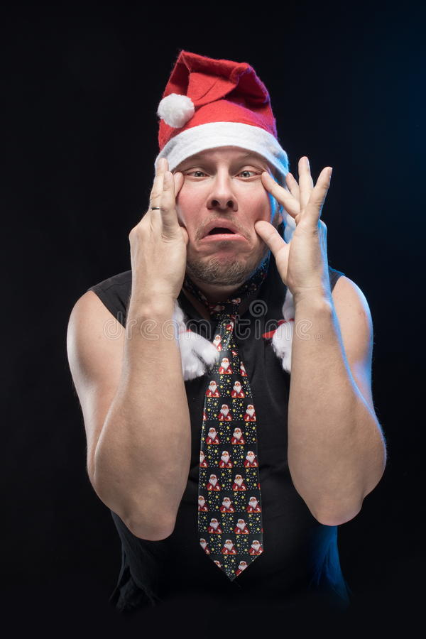 Emotional Comic actor man in cap with braids gesticulates, in anticipation of Christmas and New Year. Emotional Comic actor man in cap with braids gesticulates royalty free stock image