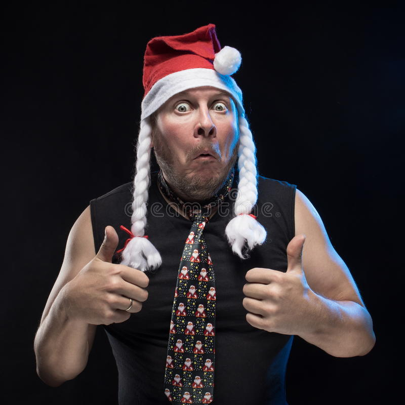 Emotional Comic actor man in cap with braids gesticulates, in anticipation of Christmas and New Year. Emotional Comic actor man in cap with braids gesticulates royalty free stock photos