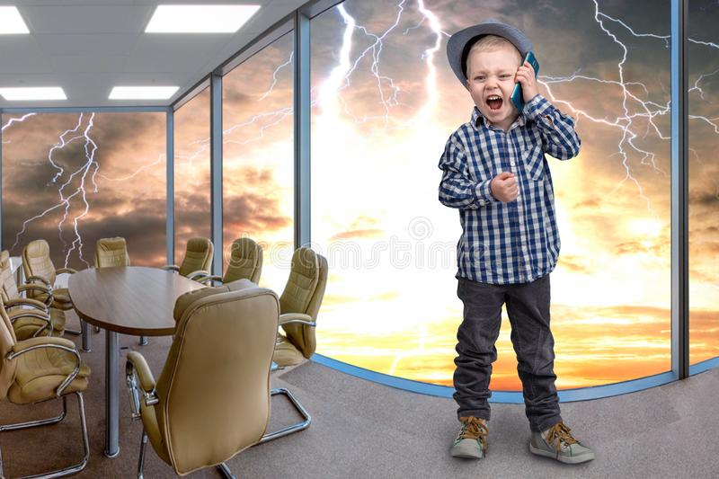 Little boss talks on his mobile phone.Emotional conversation. stock images