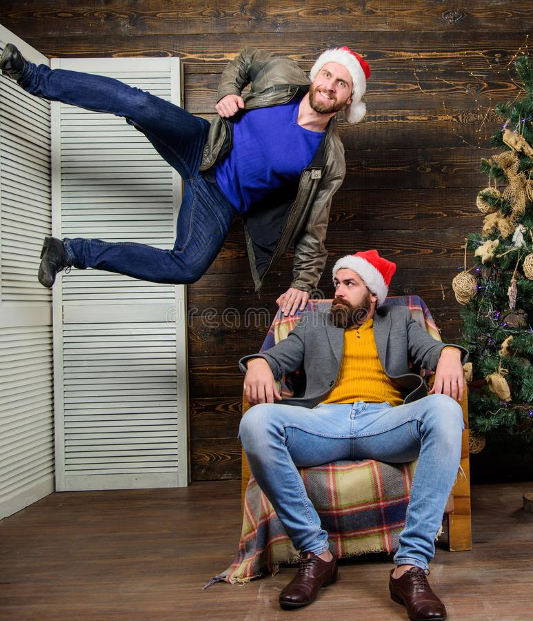 Emotional coup. Cant wait. Change point of view. Waiting for christmas. Cheerful men having fun near christmas tree. Christmas fun. Friends having fun on royalty free stock photography
