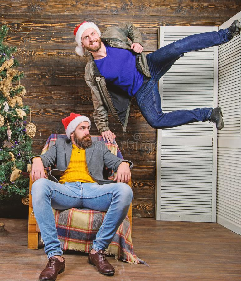 Emotional coup. Cant wait. Change point of view. Waiting for christmas. Cheerful men having fun near christmas tree. Christmas fun. Friends having fun on royalty free stock images