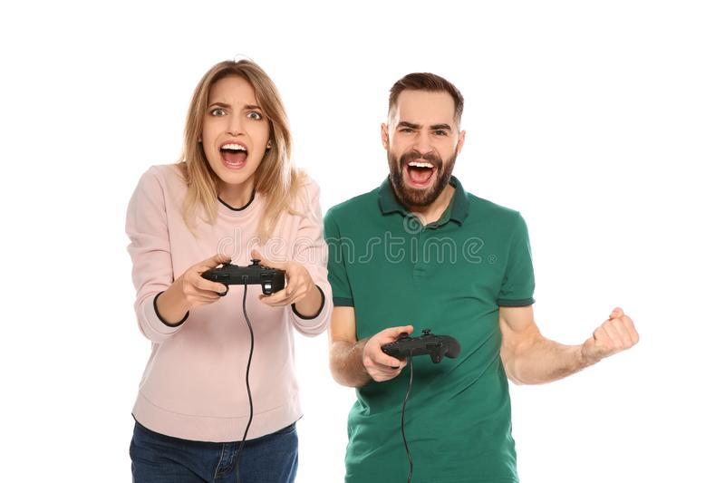 Emotional couple playing video games with controllers. Isolated on white stock photos