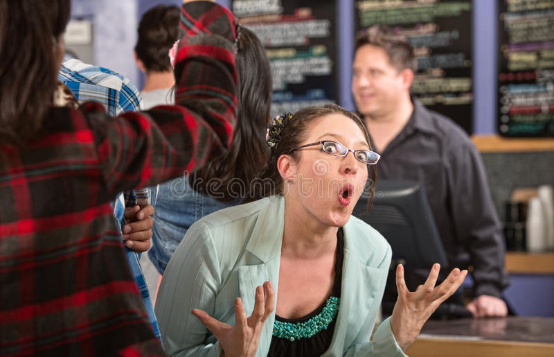Emotional Customer in Cafe. Emotional white female customer in line at coffee house stock images
