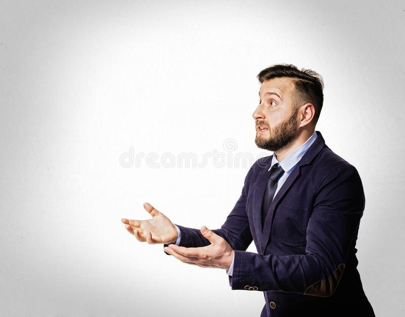 Emotional dialogue of a man in a suit royalty free stock photos