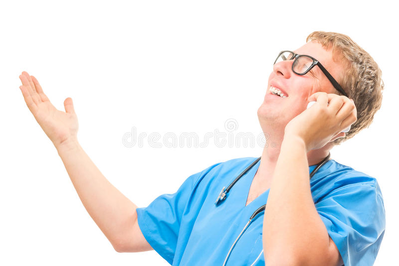 Emotional Doctor talking on the phone and gesturing. With his hands isolated stock image