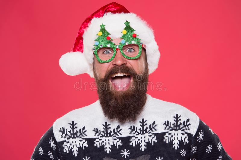 Emotional face. Good mood. Santa is coming. Santa man wear christmas tree party glasses. Happy bearded man with santa royalty free stock images