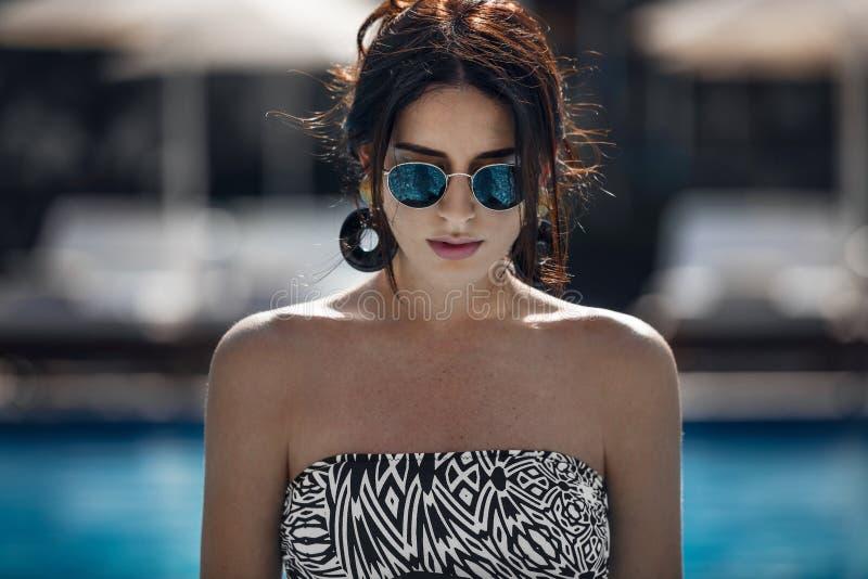 Fashion portrait of young brunette woman stock photos