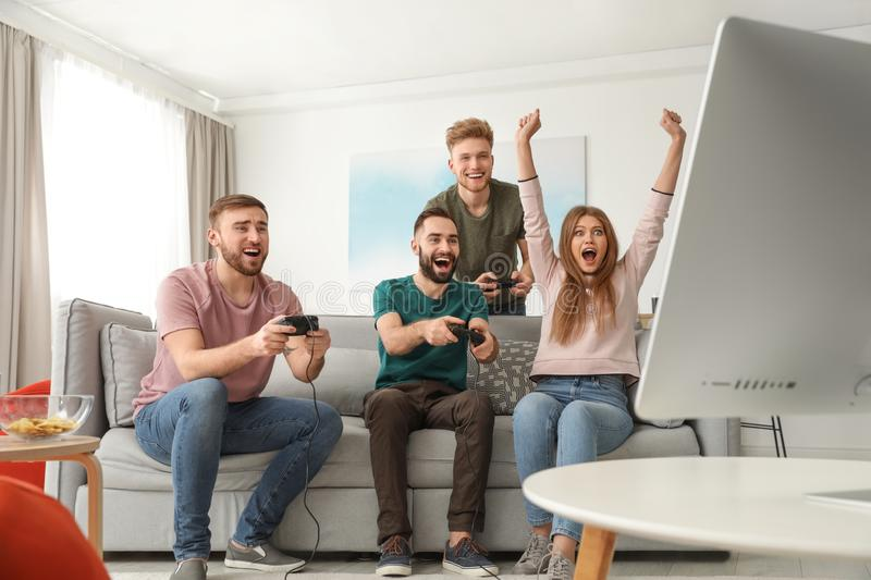 Emotional friends playing video games stock photos