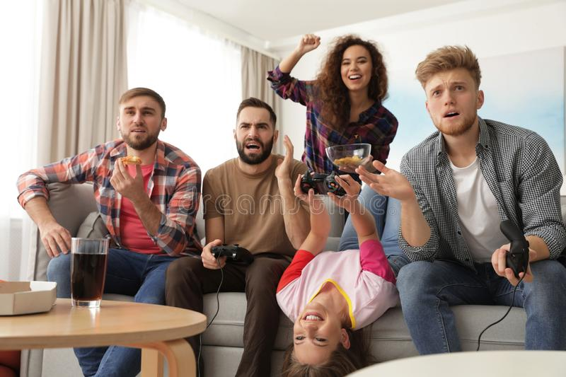 Emotional friends playing video games stock photography