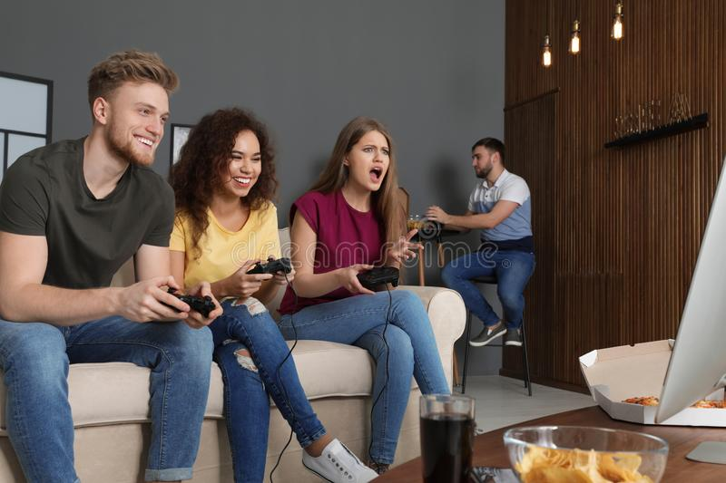 Emotional friends playing video games stock image