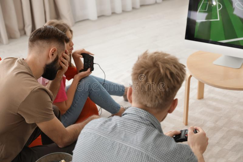 Emotional friends playing video games royalty free stock images