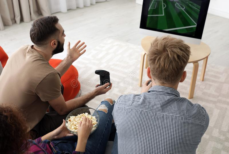 Emotional friends playing video games. At home royalty free stock photos