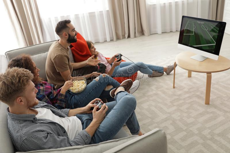 Emotional friends playing video games royalty free stock photos