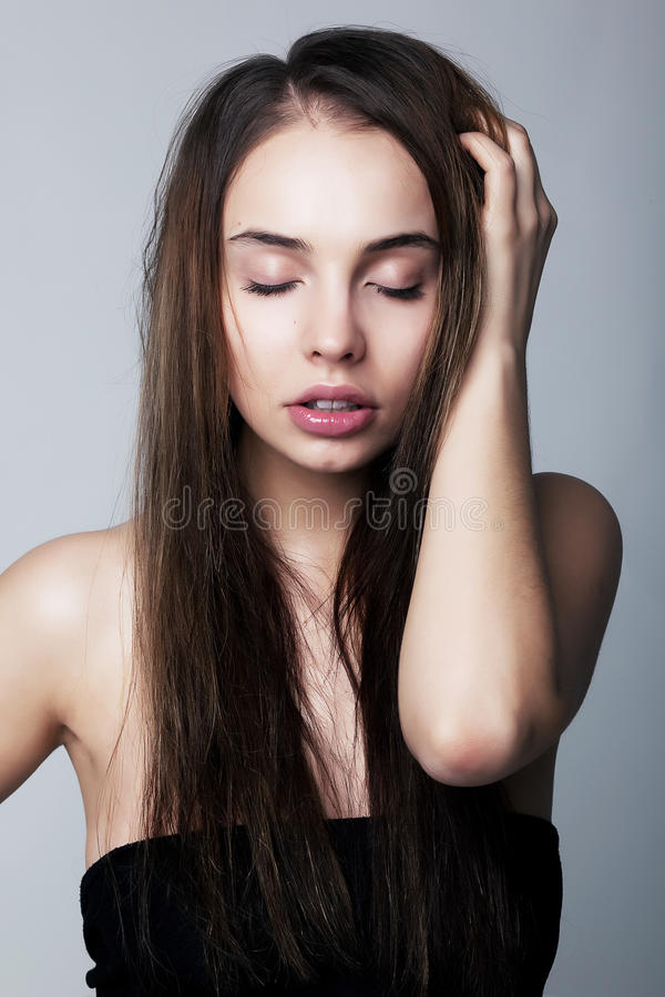 Emotional girl brunette pulling her hair royalty free stock photography