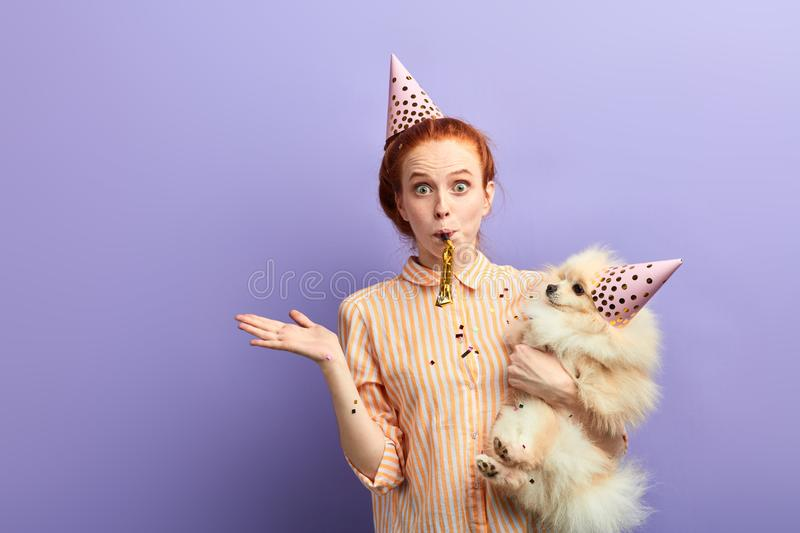 Emotional girl with bugged eyes gets pleasure from anniversary of her pet stock image