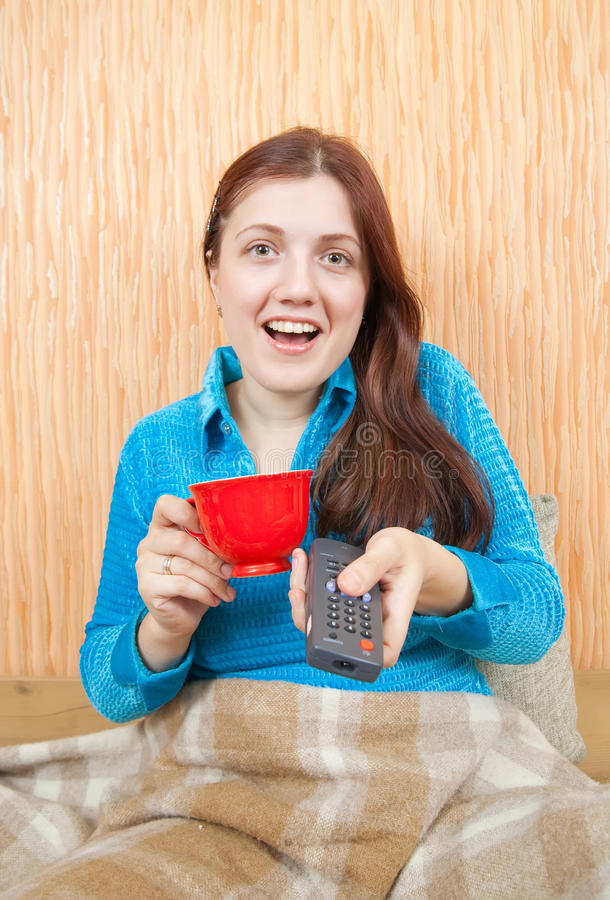 Download Emotional Girl Changing Channels With Clicker Stock Photography - Image: 13437302