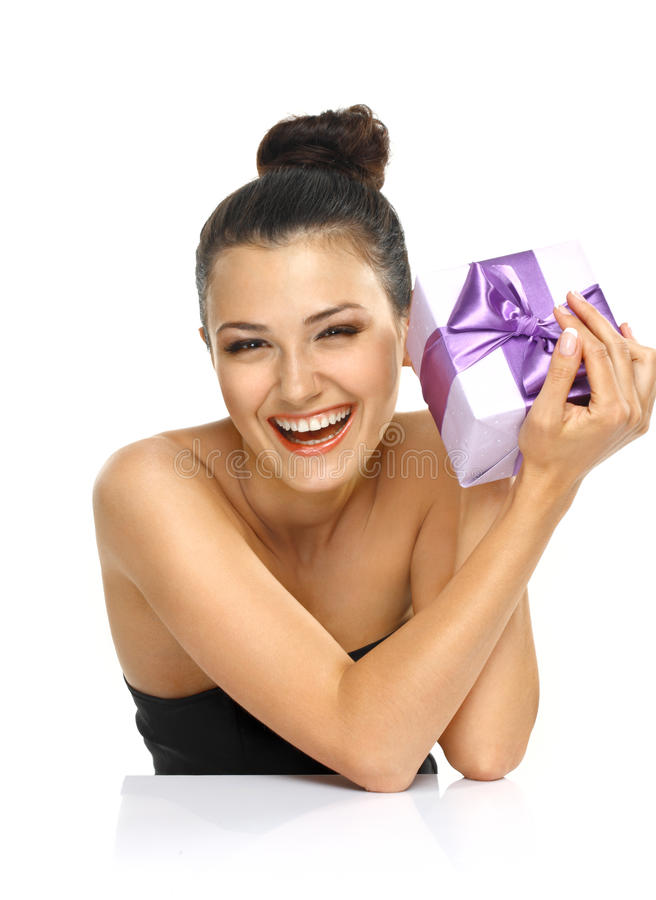 Emotional Girl with violet present. royalty free stock photography