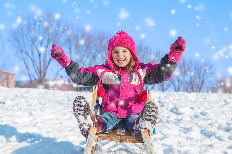 Emotional girl in winter clothes stock photography