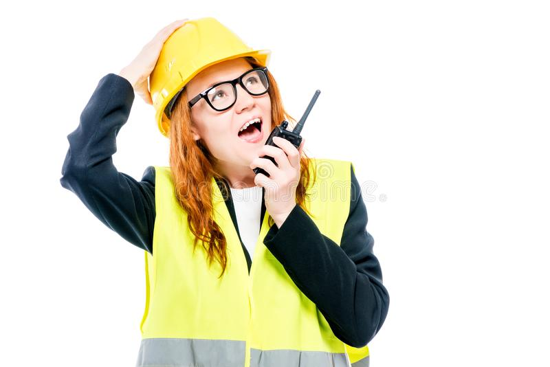 Emotional girlfriend foreman with a walkie-talkie. In his hand screams on a white background royalty free stock photography
