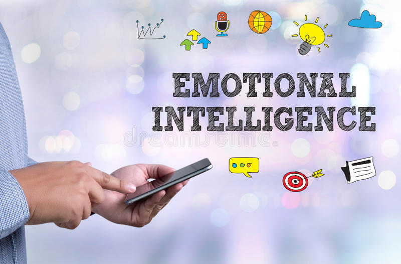 EMOTIONAL INTELLIGENCE. Person holding a smartphone on blurred cityscape background stock photos