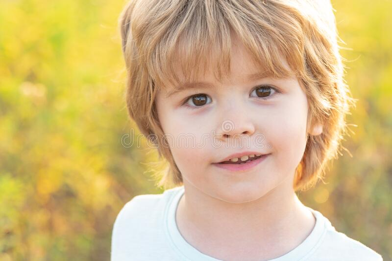 Emotional little boy on a walk. Little boy enjoy life and nature. Enjoy moment. Child care. Child play outdoors. Child royalty free stock image