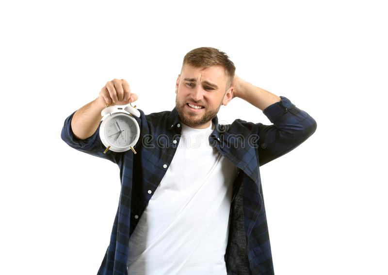 Emotional man with alarm clock on white background stock photography