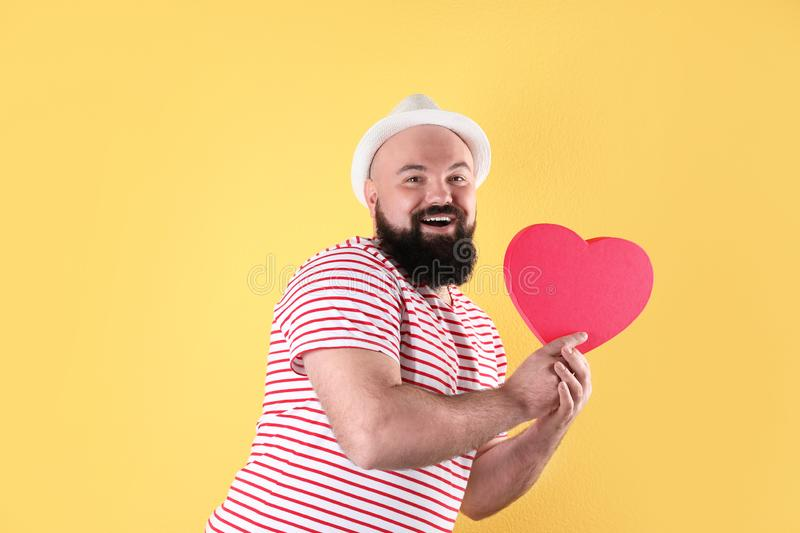 Emotional man with heart shaped box stock photography